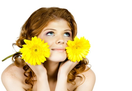 likeness: the very  pretty red-haired freckled young woman with yelow flowers , horizontal closeup portrait, isolated