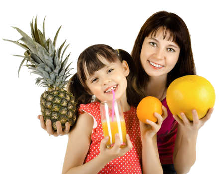 happy beauty mother and daughter, hold  pineapple, juice and orange, drink and smile, on white background, isolated Stock Photo - 12773729