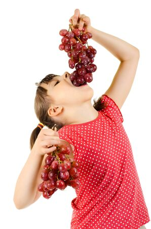 bacca: little girl eating bunch of grapes, on white background, isolated