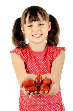 happy beauty little girl, hold  strawberries and smile, on white background, isolated Stock Photo - 12773654