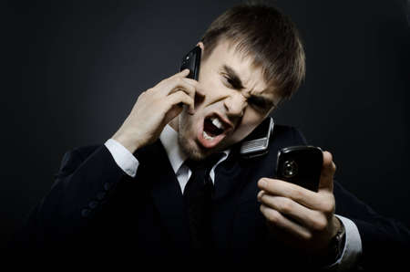 bawl: closeup portrait  the  beautiful  businessman careerist in black costume,  call and angry cry