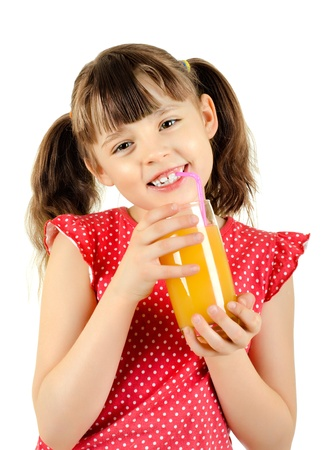happy beauty little girl, hold glass with multifruit juice and smile, on white background, isolated photo