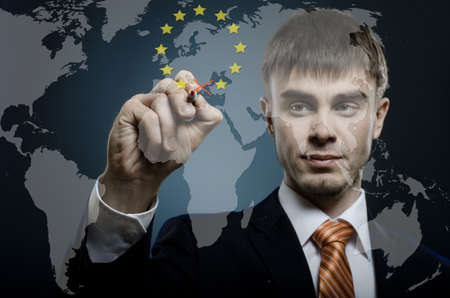 european community: businessman expunge Greece of  European Community on global world  map, economic crisis concept Stock Photo