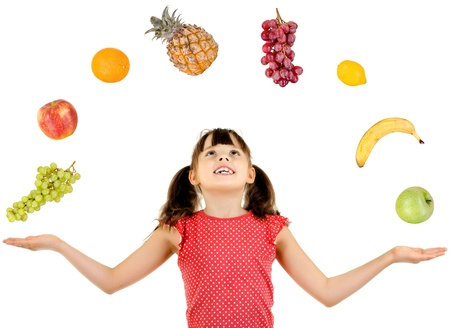 joyful beautiful little girl ,  with multi fruit set, on white background, isolated Stock Photo - 12773661