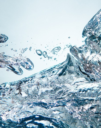 swirling: beauty abstract background of blue clear  splashes freeze water, vertical photo Stock Photo