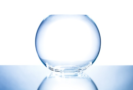 glasswork: the blue glass aquarium or bowl in the form of a globe; on white background, isolated