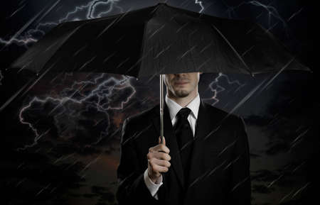 portrait  man the  beautiful  man in black costume with blak umbrella,  special-service agent or  body guard Stock Photo - 12773648