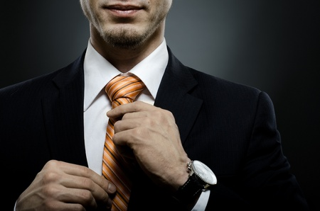 necktie: portrait  the  beautiful  businessman  in black costume tie one
