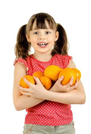 beauty little girl hold many orange and smile, on white background, isolated Stock Photo - 12773728