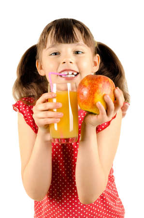 happy beauty little girl, hold glass with apple-juice and apple, drink and smile, on white background, isolated photo