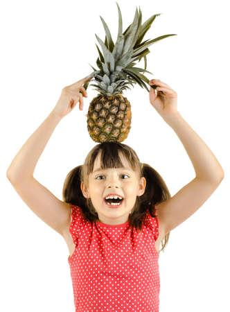 beauty little girl hold big pineapple  and smile, on white background, isolated Stock Photo - 12773783