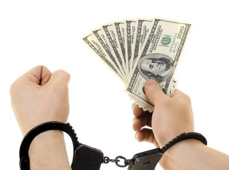 evildoer: hand in shackle hold  currency note dollars, on white background, isolated Stock Photo