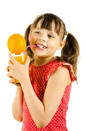 happy beauty little girl, hold glass with multifruit juice and smile, on white background, isolated Stock Photo - 12921761