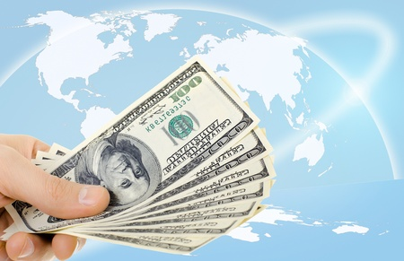 taker: cash  currency note dollar in hand, on blue map world  background