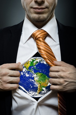 businessman  in black costume throw open one's shirt image planet Stock Photo - 12921775