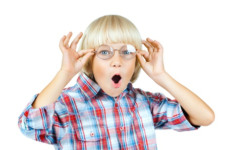 little children boy gaily  astonished stare on camera  above glasses , on white background, isolated