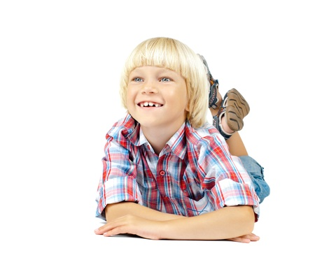 lively: the little children boy slyly smile,  lying on white background, isolated