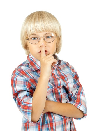 silently: little children boy stare on camera,  put finger to nose, on white background, isolated