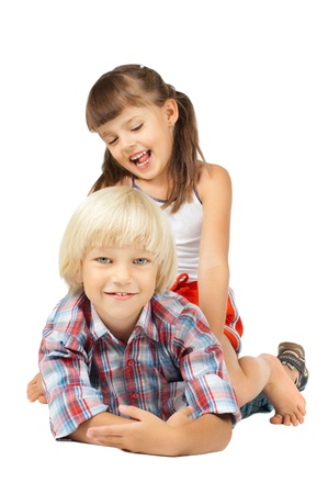 sissy: two  little children sitting embrace and smile, on white background, isolated Stock Photo