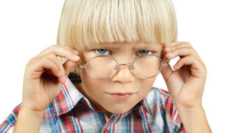 little children boy stare on camera  above glasses , on white background, isolated photo