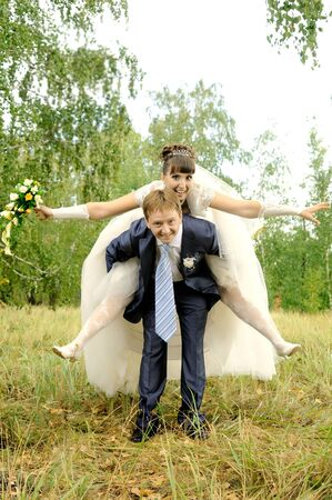cutie:  cutie happy married  couple  on nature in park ,  embrace and smile