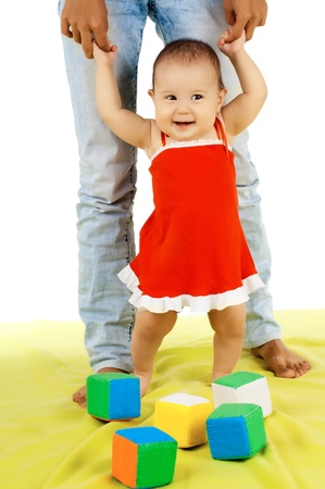 the very  beautiful  little kid , learn  walk with mother,  on white background photo