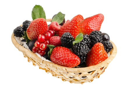 strawberry baskets: still life of  heap multi-coloured  berrys in  basket, on white background, isolated