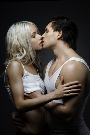 muscular handsome sexy guy with pretty woman, on dark background, glamour  light Stock Photo - 13590037