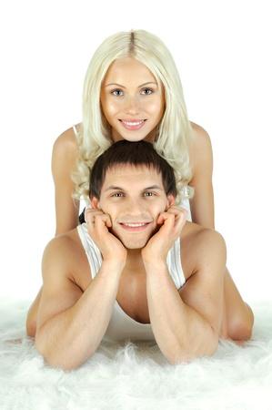 necking: horizontal photo very happy  pretty couple, smile,  lie on white fur