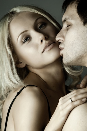 passionate kissing: guy with pretty woman, happy couple, very close face, girl look on camera Stock Photo
