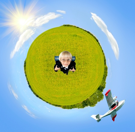 plane flying in sky around green planet with joy little boy, sunny day, square photo photo
