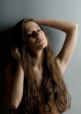 the very  pretty woman portrait , dark  long hair , sensual look photo
