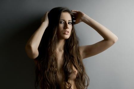 the very  pretty woman portrait , dark  long hair , sensual look photo