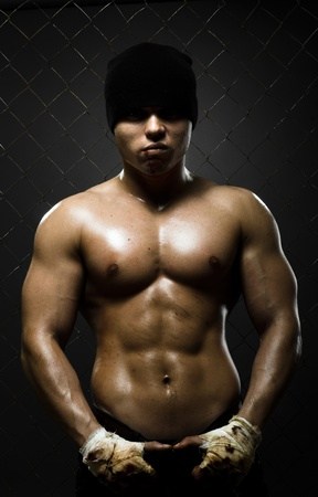 vertical photo  muscular young  guy street-fighter,  aggression look, hard light Stock Photo - 14160670