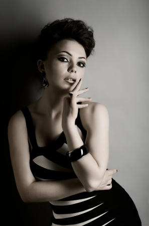 the very  pretty woman portrait , sit on chair, sensual look photo