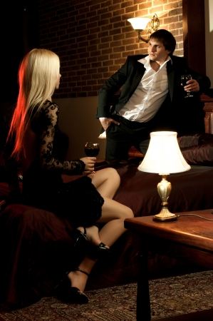 romantic evening date in hotel room, guy with  sexy girl,  on bed photo