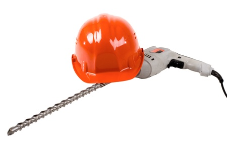 perforator: photo  red  safety cap and perforator with  stone-drill, close up on white background, isolated