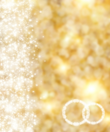 festal: the beautiful holiday abstract gold  background  with  shining sparklets, weddings concept Stock Photo