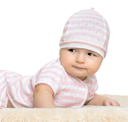 the very  beautiful  little baby  in pink dress, lie on stomach,  on white background, isolated Stock Photo - 14609064