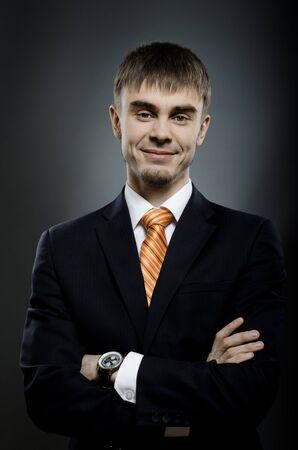 portrait  the  beautiful  businessman careerist in black costume without necktie Stock Photo - 14609081