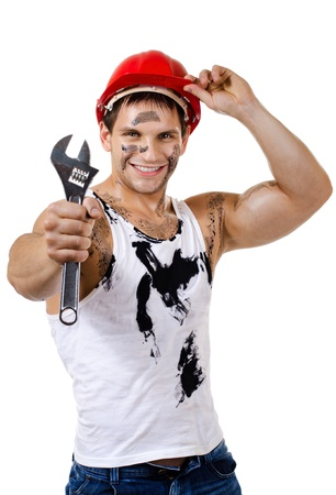 the beauty muscular worker  man, in  safety helmet  hold  big wrench  in hands and smile, on white background, isolated photo