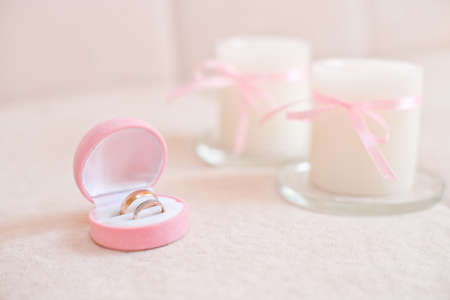 wedding accessories: group object of wedding jewellery accessory, church rings . pink light Stock Photo