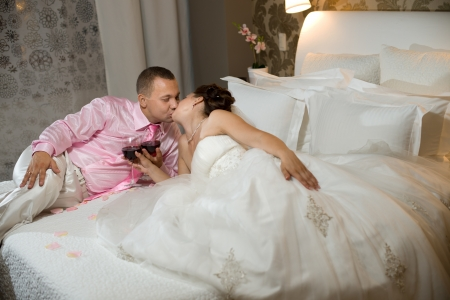 newly married couple  in hotel room,  romance wedding night  photo