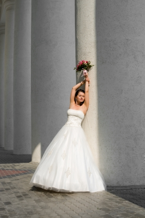fiancee: vertical photo beautiful young  fiancee in white wedding dress, outdoor Stock Photo