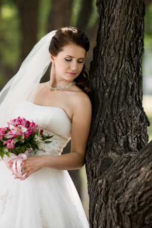 fiancee: vertical portrait beautiful young  fiancee in white wedding dress, outdoor