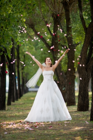 toss: joyful  beautiful  fiancee, on nature in wood, toss up rose petal