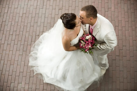 happy newly married couple  , romance embrace  and kiss outdoor photo