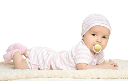 the very  beautiful  little baby  in pink dress, lie on stomach,  on white background, isolated Stock Photo - 14778965
