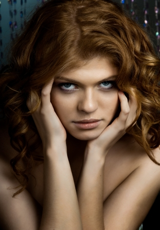 the very  pretty red-haired young woman,  sensual  captivating look , vertical portrait photo