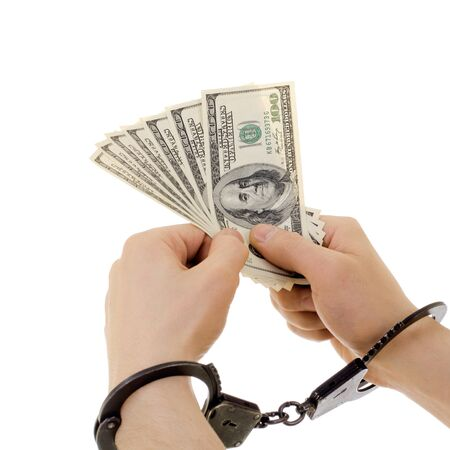 hand in shackle hold  currency note dollars, on white background, isolated photo